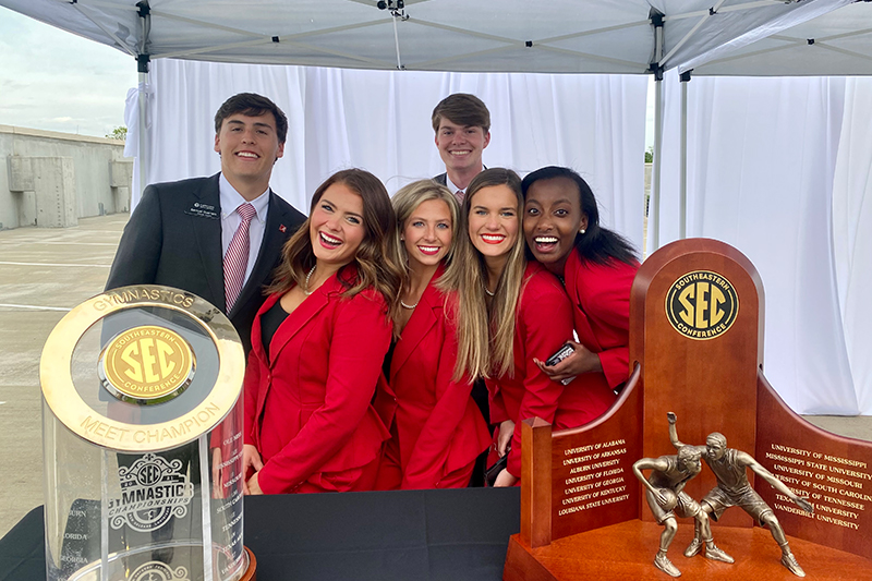 Capstone men and women pose with SEC championship trophy