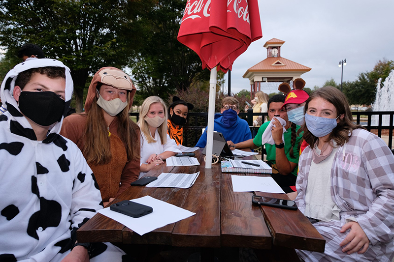 gCapstone men and women posing in halloween costumes