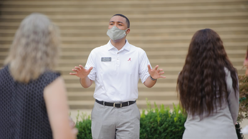Capstone man gives tour while wearing PPE
