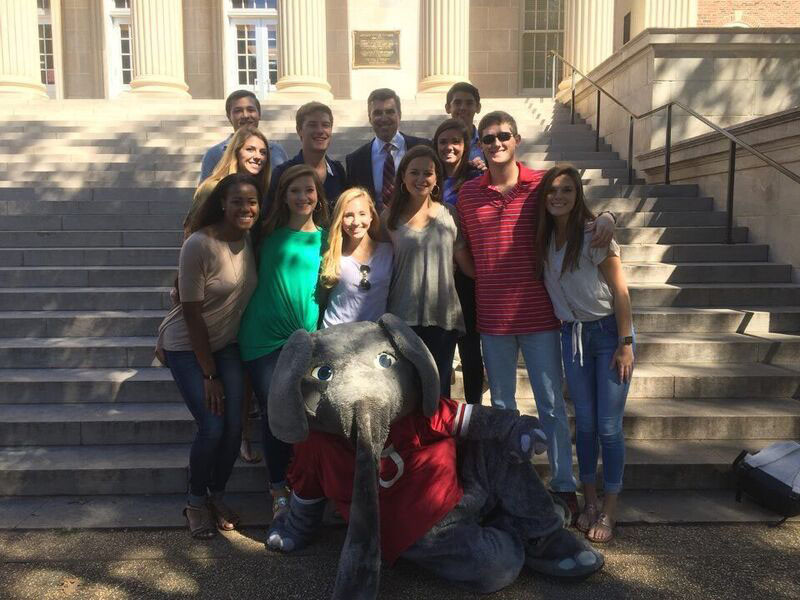 A group of people pose with Big Al on the steps of Gorgas.