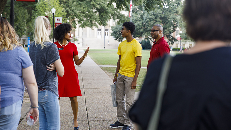 A Capstone woman gives a tour on The Quad.
