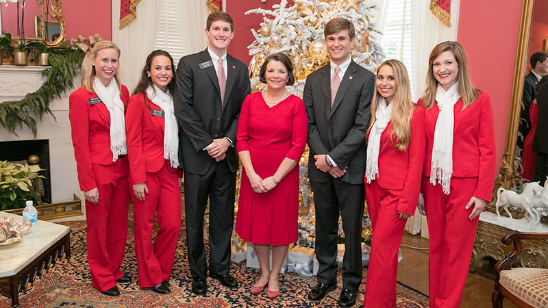 A group poses in the President's Mansion at Christmas.